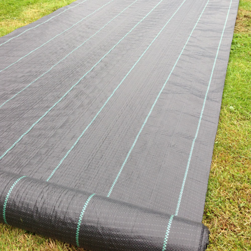 Woven ground Cover Weed Control Fabric laid on grass by Yuzet.