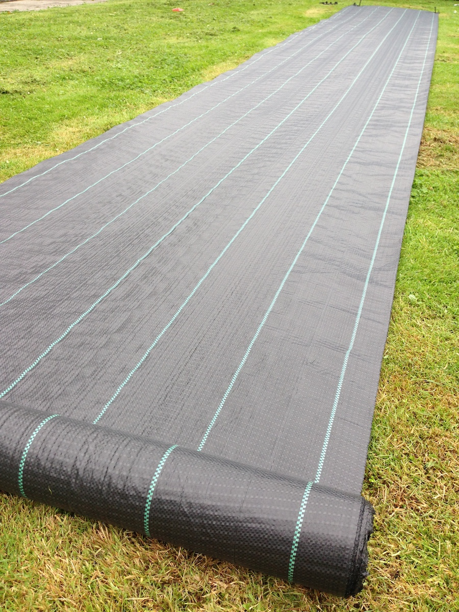Ground Cover being rolled out in preperation for installation by Yuzet®.